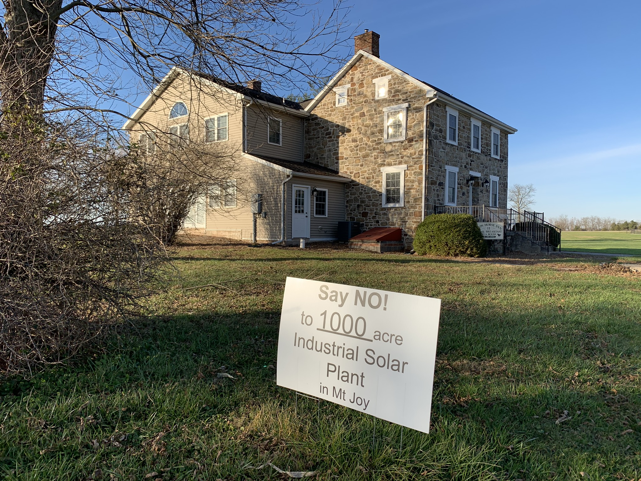 One of the many signs protesting a proposed solar project in Mount Joy Township, Adams County is seen here in front of the Iron Horse Inn on Nov. 24