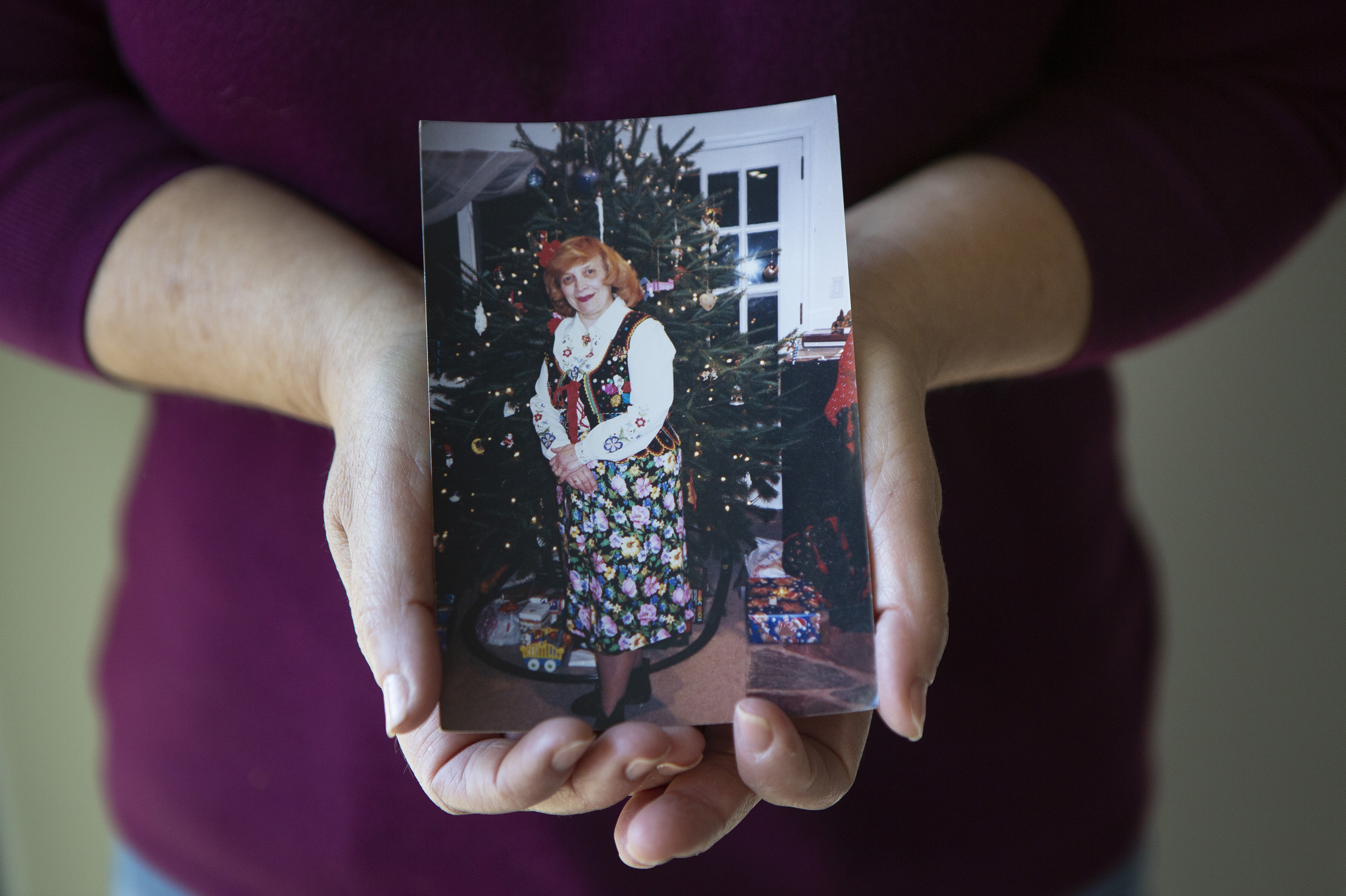 Dorothy Cassaro holds a photo of her mother, Annette Kociolek, 93, who passed away on March 30.