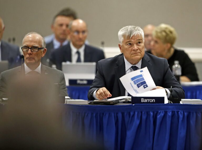 FILE PHOTO: Penn State President Eric J. Barron, right, listens during a Penn State University Board of Trustees meeting on the campus of Penn State Harrisburg in Middletown, Pa., Friday, July 21, 2017. (Chris Knight / AP Photo)