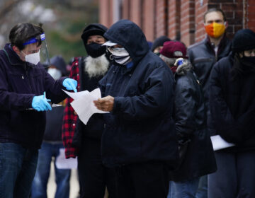People line up outside a community center to take a free COVID-19 test