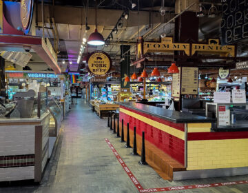 Reading Terminal Market in April. Some stands were open, but customers were few. (Mark Henninger/Imagic Digital)
