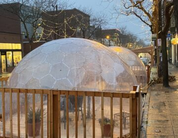 The popular Seattle restaurant San Fermo allows only two people inside each of its enclosed dining igloos at a time — to reduce the risk that people from different households will dine together. (Will Stone)