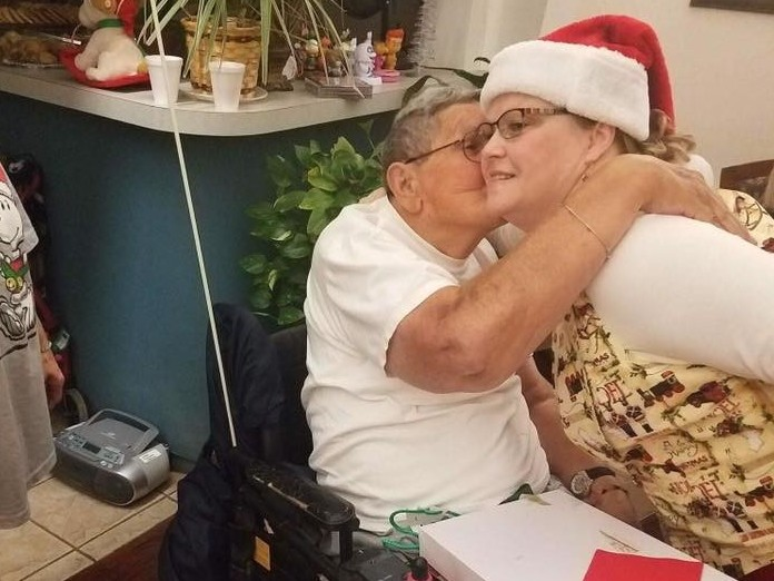 A resident of the Cordell Christian Home in Cordell, Okla., kisses Mrs. Claus at the annual holiday party in 2017