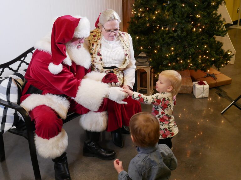 Keith and Melanie Hubbard, who portray Santa and Mrs. Claus in Oklahoma greet their grandchildren in 2019.