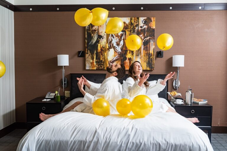 Two women in a hotel celebrating with balloons
