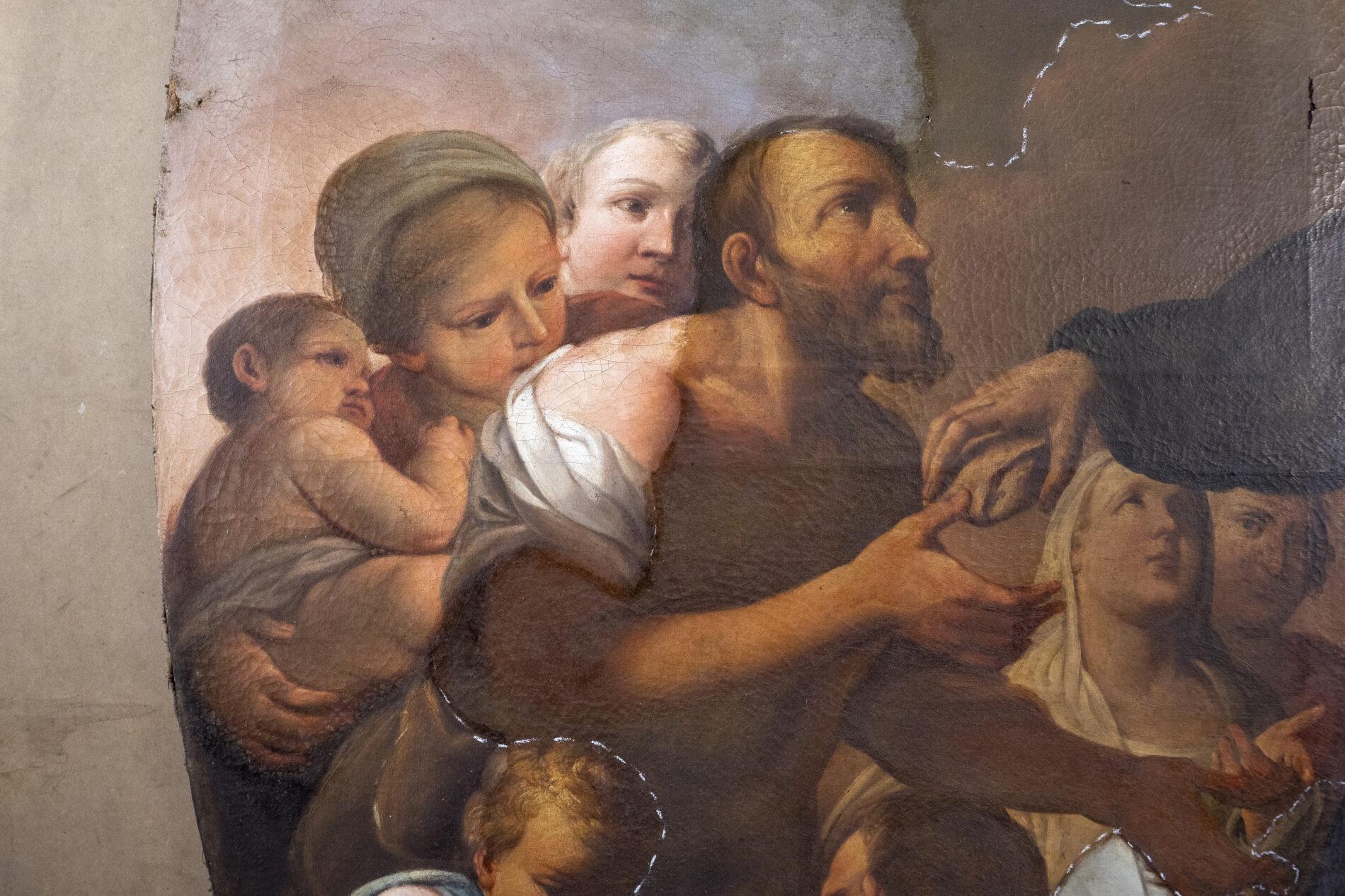 Cleaning test of Violante Ferroni's Saint John of God Feeds the Poor.