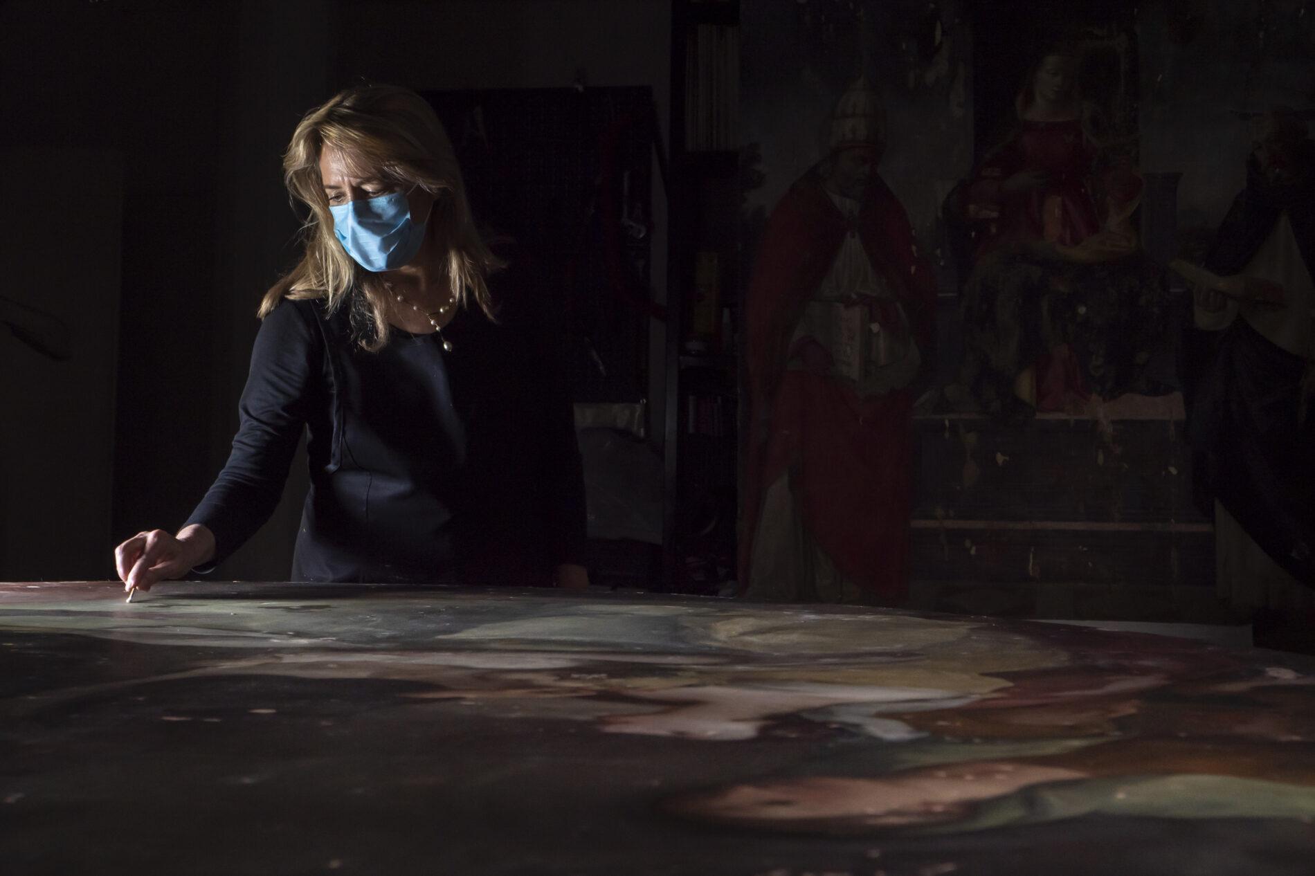 Conservator Elisabeth Wicks at work.