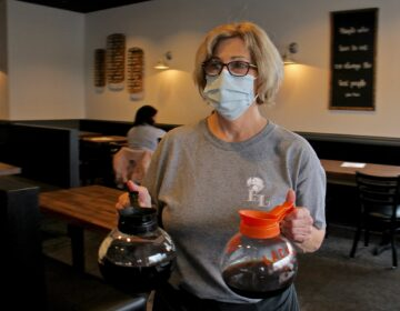 Laura Tierney, manager of Bonnet Lane Family Restaurant in Abington, Pa., serves customers in the dining room. (Emma Lee/WHYY)