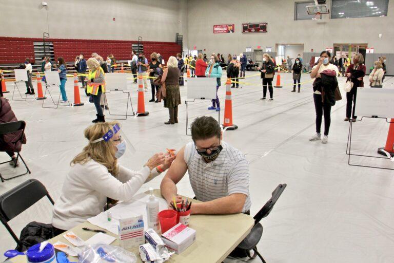 Nicholas Drago gets a COVID-19 vaccination