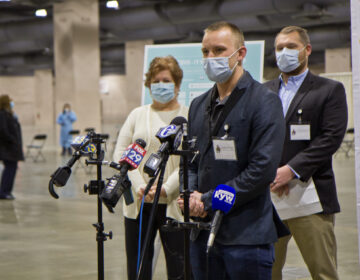 Philly Fighting COVID CEO Andrei Doroshin speaks at the opening of the community vaccine clinic at the Pennsylvania Convention Center. (Kimberly Paynter/WHYY)