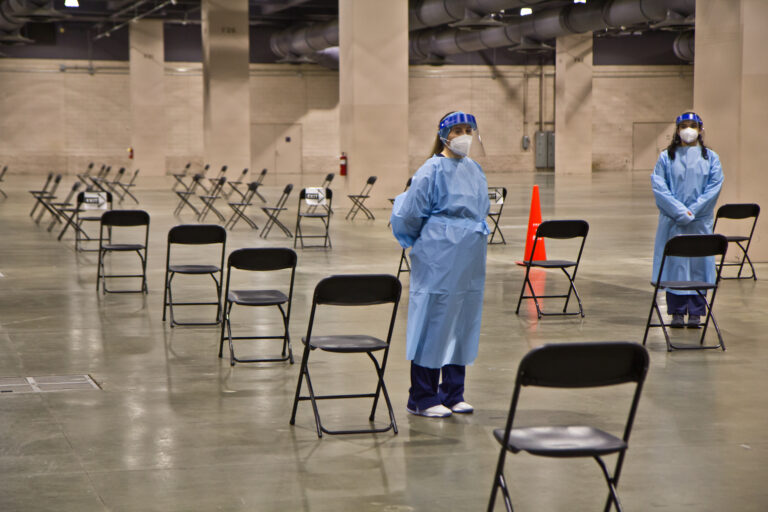 After receiving the vaccination, patients wait under observation at the mass vaccine clinic at the Pennsylvania Convention Center. (Kimberly Paynter/WHYY)
