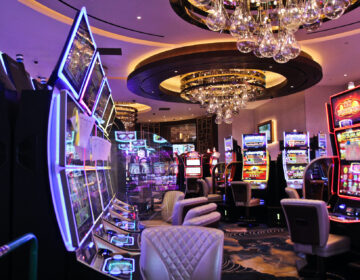 Electronic games are separated by plexiglass at Live! Casino and Hotel Philadelphia due to the COVID-19 pandemic. (Kimberly Paynter/WHYY)
