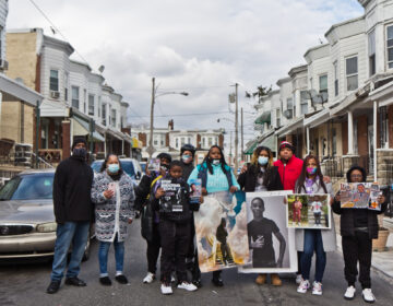 Members of the organization Voices by Choices held an event on the Simpson Street block where 7 year-old Zamar Jones was fatally shot in the summer of 2020 for those affected by gun violence on Martin Luther King Jr. Day. (Kimberly Paynter/WHYY)