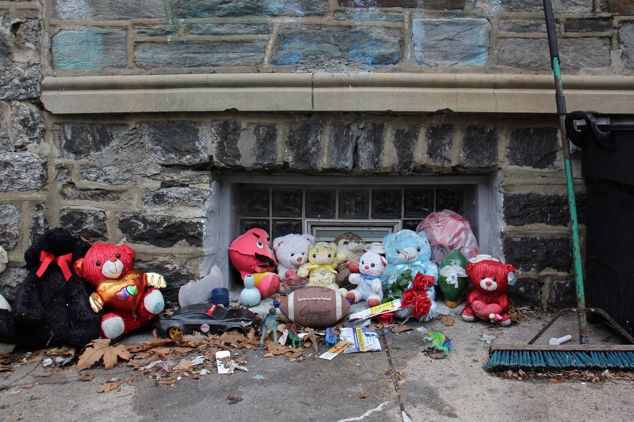 A memorial for Zamar Jones remains in front of his house on North Simpson Street