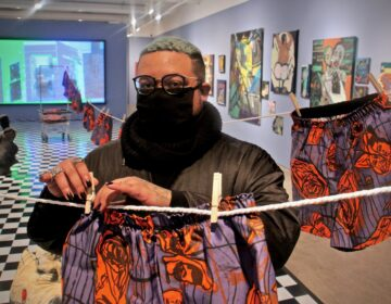 During a residency at the Fabric Workshop and Museum, Philadelphia-based artist Jonathan Lyndon Chase created a vibrant purple and orange silk screened fabric which plays a recurring role in their exhibit, Big Wash. (Emma Lee/WHYY)