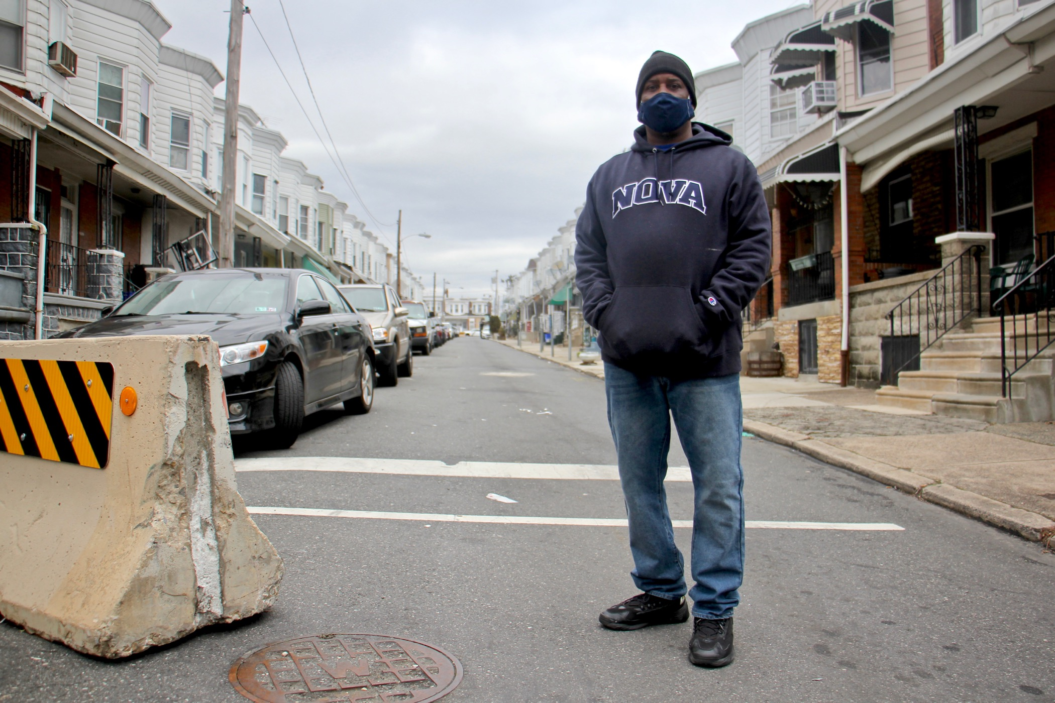 Derrick Smith, wearing a face mask, stands on Simpson Street