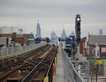 The Philadelphia skyline is seen from the Market Frankford platform at 63rd Street. (Emma Lee/WHYY)
