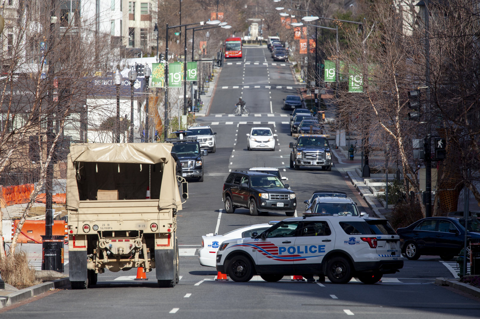 Military and police vehicles block off street traffic in D.C.