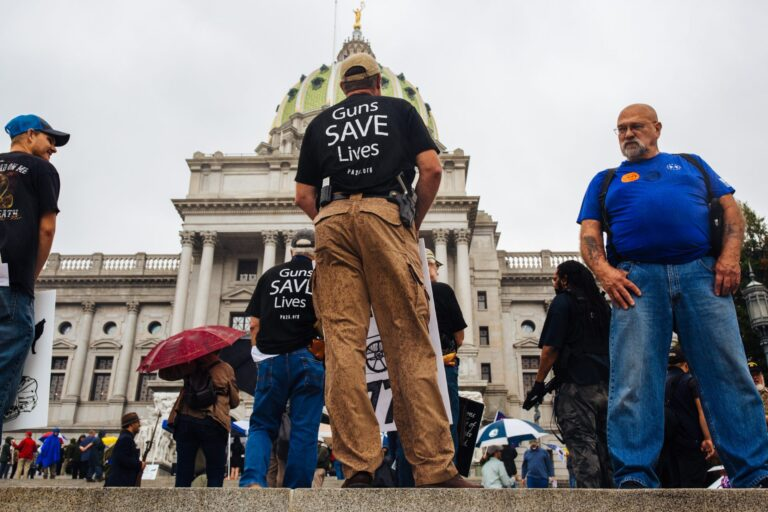 2nd Amendment Rally attendees carry guns and signs on the Capitol steps in Harrisburg, Pa., on Sept. 29, 2020. (Kate Landis/WITF)