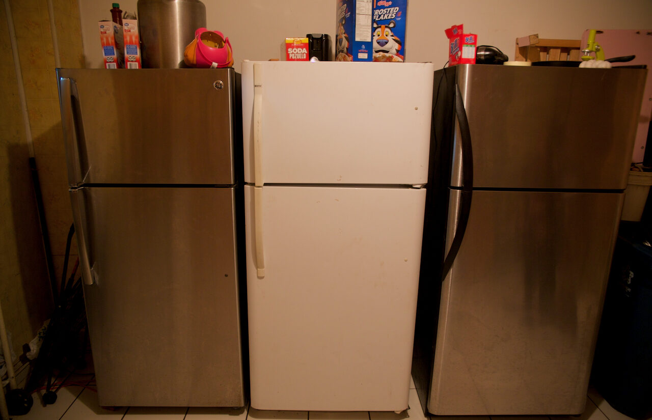 The apartment has three refrigerators — one for each family who lives there. | El apartamento tiene tres refrigeradores, uno para cada familia que vive allí. (Tony Rocco/WHYY)