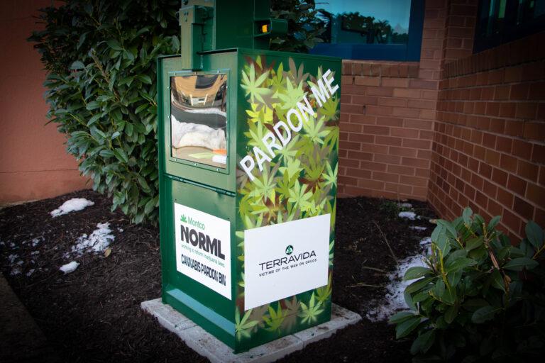 An old newspaper box holds marijuana pardon applications