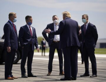FILE PHOTO: President Donald Trump, second from right, speaks with from left, Rep. Fred Keller, Rep. Dan Meuser, Rep. Brian Fitzpatrick, Rep. Scott Perry after arriving at Lehigh Valley International Airport in Allentown, Pa., Thursday, May 14, 2020. (Evan Vucci / AP Photo)