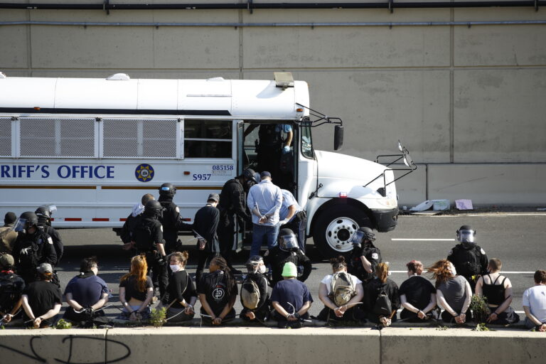 Police detain protesters in the aftermath of a march calling for justice over the death of George Floyd on Interstate 676 in Philadelphia, Monday, June 1, 2020. Floyd died after being restrained by Minneapolis police officers on May 25. (AP Photo/Matt Rourke)