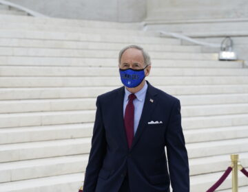 Sen. Tom Carper, D-Del., on the front steps of the U.S. Supreme Court building on Thursday, Sept. 24 2020, in Washington. (AP Photo/Alex Brandon)