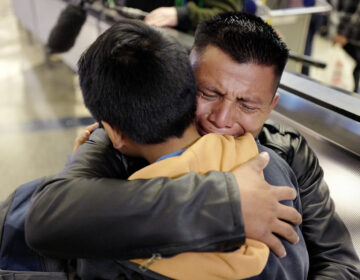 FILE - In this Wednesday, Jan. 22, 2020, file photo, David Xol-Cholom, of Guatemala, hugs his son Byron at Los Angeles International Airport as they reunite after being separated during the Trump administration's wide-scale separation of immigrant families, in Los Angeles. A court-appointed committee has yet to find the parents of 628 children separated at the border early in the Trump administration. (AP Photo/Ringo H.W. Chiu, File)