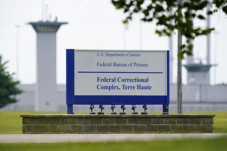 FILE - This Aug. 28, 2020, file photo shows the federal prison complex in Terre Haute, Ind.   (AP Photo/Michael Conroy, File)A federal judge said the Justice Department unlawfully rescheduled the execution of the only woman on federal death row, potentially setting up the Trump administration to schedule the execution after president-elect Joe Biden takes office. U.S. District Court Judge Randolph Moss also vacated an order from the director of the Bureau of Prisons that had set Lisa Montgomery's execution date for Jan. 12, 2021.  (AP Photo/Michael Conroy)