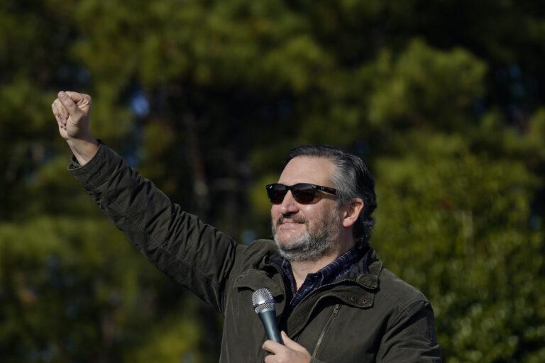 Sen. Ted Cruz, R-Texas, greets a crowd before he speaks at a campaign rally for Sen. Kelly Loeffler, R-Ga., on Saturday, Jan. 2, 2021, in Cumming, Ga. (AP Photo/Brynn Anderson)