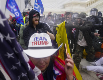 Pro-Trump insurrectionists try to break through a police barrier, Wednesday, Jan. 6, 2021, at the Capitol in Washington. (AP Photo/John Minchillo)