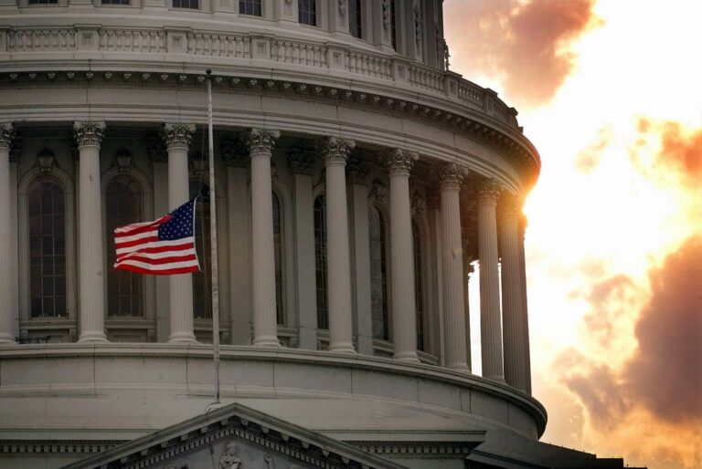 In this July 24, 1998, file photo, a flag flies at half-staff on Capitol Hill in honor of two Capitol police officers who were killed after a gunman burst through security barriers. (AP Photo/Doug Mills)