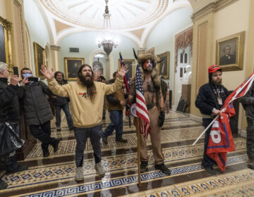 Pro-Trump insurrectionists are confronted by Capitol Police officers outside the Senate Chamber