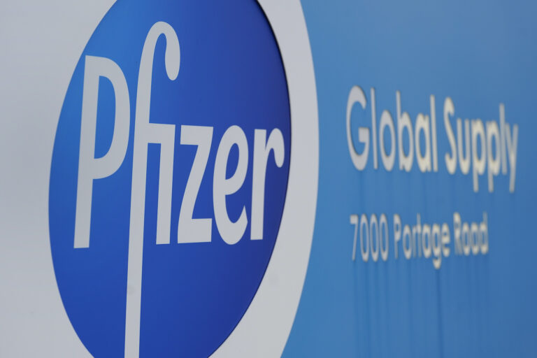 A Pfizer Global Supply Kalamazoo manufacturing plant sign is shown in Portage, Mich., Friday, Dec. 11, 2020. (AP Photo/Paul Sancya)