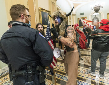 Supporter of President Donald Trump are confronted by Capitol Police officers outside the Senate Chamber inside the Capitol, Wednesday, Jan. 6, 2021 in Washington.  (AP Photo/Manuel Balce Ceneta)
