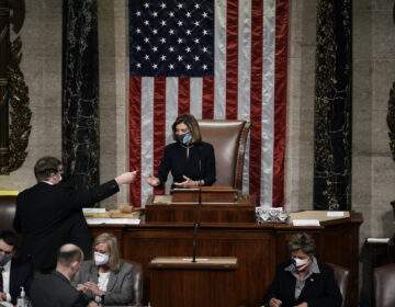 Speaker of the House Nancy Pelosi, D-Calif., leads the final vote of the impeachment of President Donald Trump, for his role in inciting an angry mob to storm the Congress