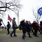 In this Jan. 6, 2021, file photo, Trump supporters gather on the Washington Monument grounds in advance of a rally in Washington. (AP Photo/Julio Cortez)