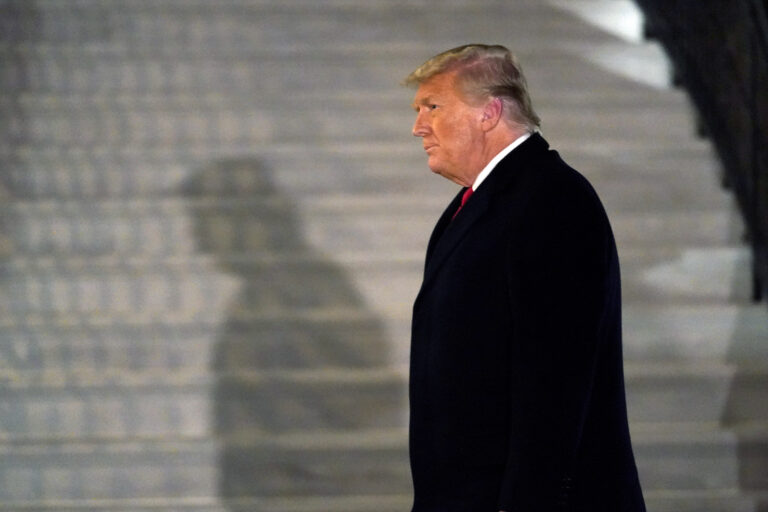 President Donald Trump arrives on the South Lawn of the White House, Tuesday, Jan. 12, 2021, in Washington. The president was returning from Texas. (AP Photo/Gerald Herbert)