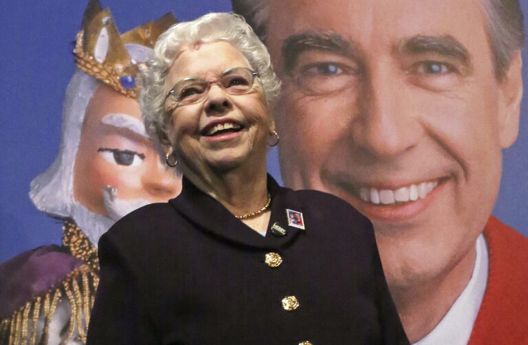 Fred Rogers wife, Mrs. Joanne Rogers, stands in front of a giant Mister Rogers Forever Stamp following the first-day-of-issue dedication in WQED's Fred Rogers Studio in Pittsburgh, Friday, March 23, 2018. (AP Photo/Gene J. Puskar)