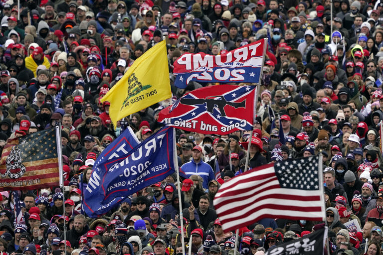 People listen as President Donald Trump speaks during a rally Wednesday, Jan. 6, 2021, in Washington. (AP Photo/Evan Vucci)