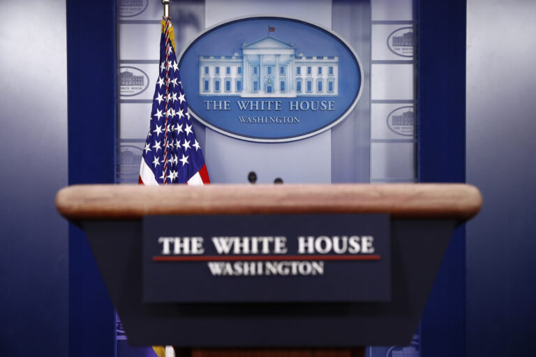A podium in the James Brady Press Briefing Room of the White House