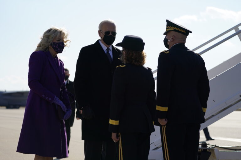 President-elect Joe Biden and his wife Jill Biden are greeted by Delaware Adjutant General Michael Berry and his wife Gen. Karen Berry before they board a plane at New Castle Airport, Tuesday, Jan. 19, 2021, in New Castle, Del. (AP Photo/Evan Vucci)