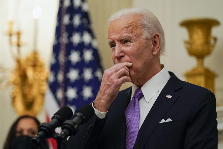 President Joe Biden pauses as he speaks about the coronavirus, accompanied by Vice President Kamala Harris, in the State Dinning Room of the White House, Thursday, Jan. 21, 2021, in Washington. (AP Photo/Alex Brandon)