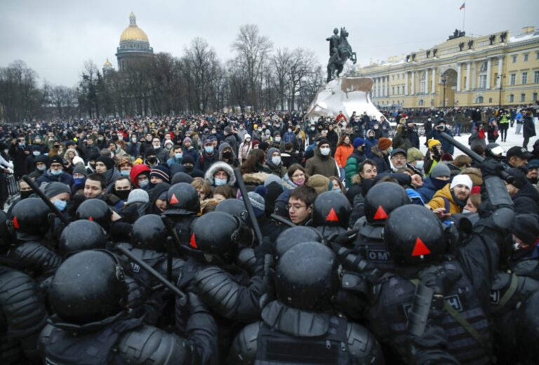 People clash with police during a protest against the jailing of opposition leader Alexei Navalny in St.Petersburg, Russia, Saturday, Jan. 23, 2021. (AP Photo/Dmitri Lovetsky)