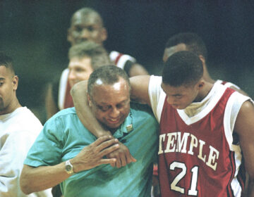 Temple University guard Eddie Jones, right, keeps basketball coach John Chaney in a headlock as they walk off the court after their practice session at the USAir Arena, Thursday, Match 17, 1994. (AP Photo/Ted Mathias)