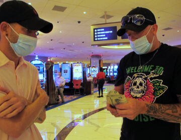 Gamblers count their money before starting to make bets at the Hard Rock casino in Atlantic City