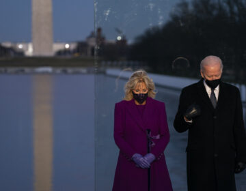 President-elect Joe Biden and his wife, Dr. Jill Biden, stand in silence at a COVID-19 memorial event