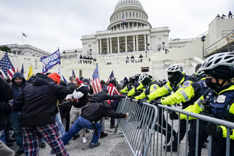 Trump supporters try to break through a police barrier at the U.S. Capitol