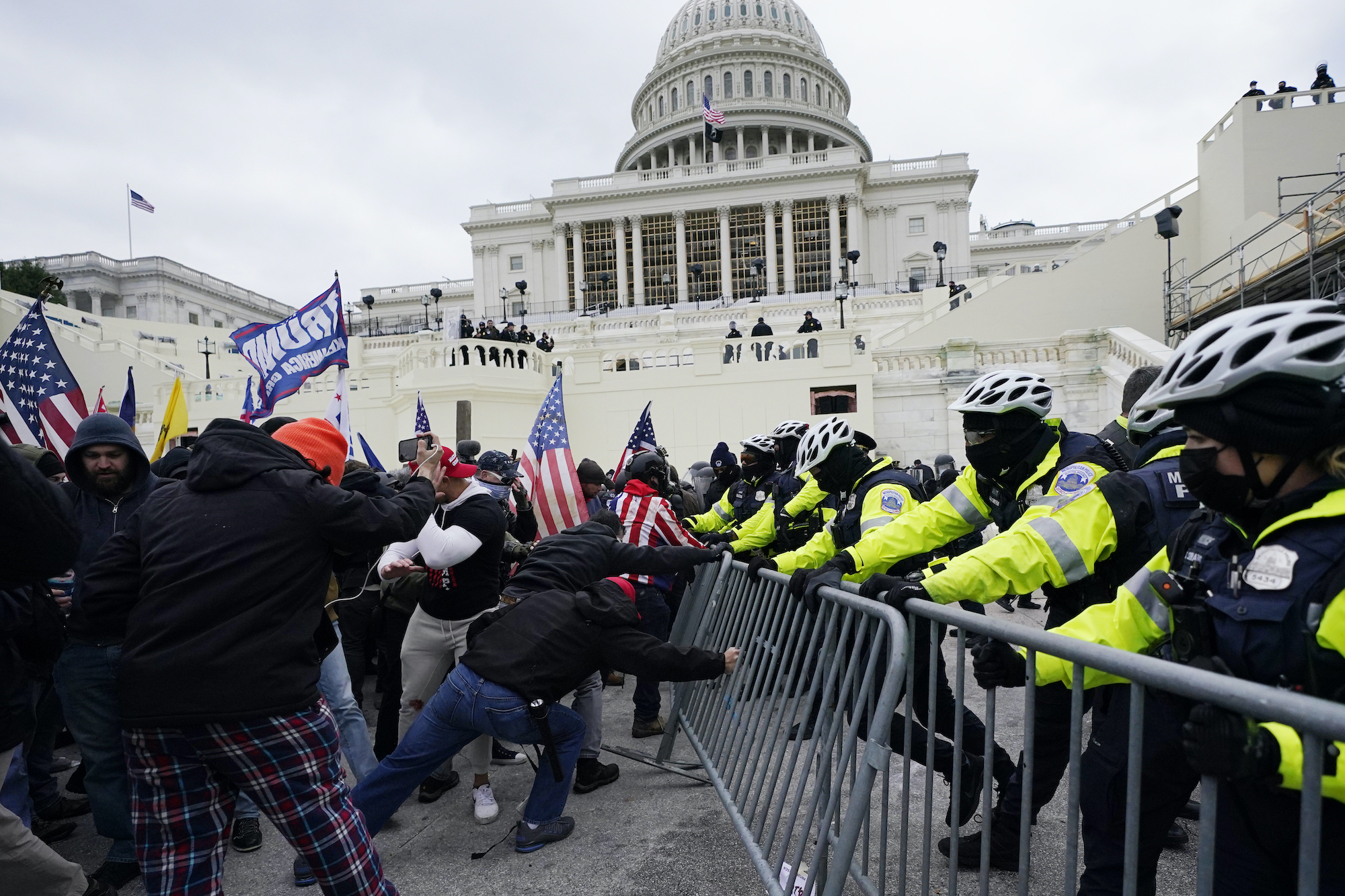 Pro-Trump insurrectionists try to break through a police barrier, Wednesday, Jan. 6, 2021, at the Capitol in Washington.